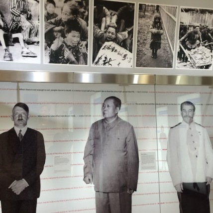 Lifesize portraits of past dictators according to height