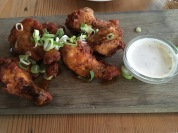 Buffalo wings from Mondiall Kitchen & Bar. A beautifully situated restaurant at the V&A Waterfront. The backdrop of Table Mountain and the sunset were incredible here. The food and wine were delicious. Try their burger and truffle fries!