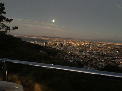 The sunset tour bus tour had just ended. The activity involves driving to the top of Signal Hill and watching the sun set over the Atlantic Ocean. This is a view of the full moon.