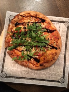 My pizza: pink sauce, roasted garlic, chicken, bourbon bacon, pineapple , grape tomatoes, smoked gouda, parmesan, ricotta, arugula, and balsamic glaze.
