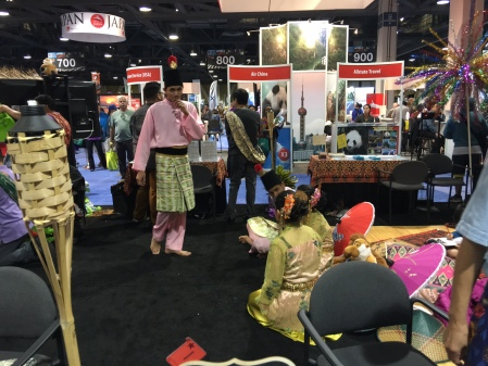 Malaysian dancers at their booth