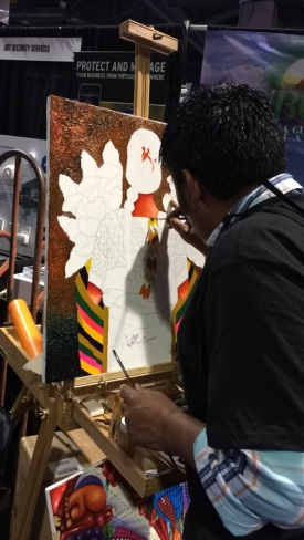 Peruvian artist working at the booth
